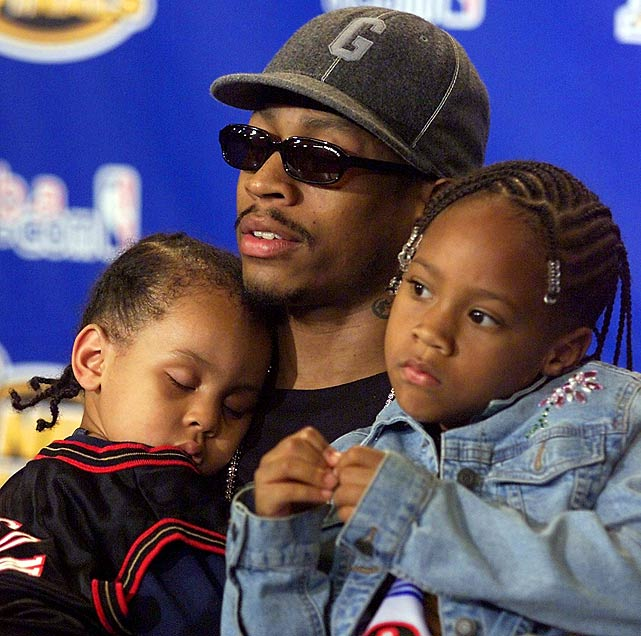 Holding his son, Deuce, and daughter, Tiara, Iverson speaks with the media after a Game 2 loss to the Lakers in the 2001 NBA Finals. He was a force throughout the series, averaging 35.6 points per game but Shaq, Kobe and Co. defeated Philadelphia four games to one.