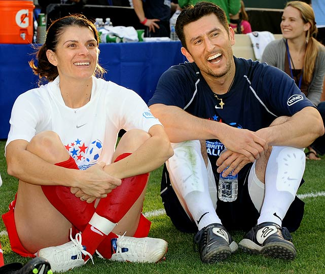 Retired soccer player Mia Hamm and ballplayer Nomar Garciaparra have been married since 2003 with twin girls and a son.