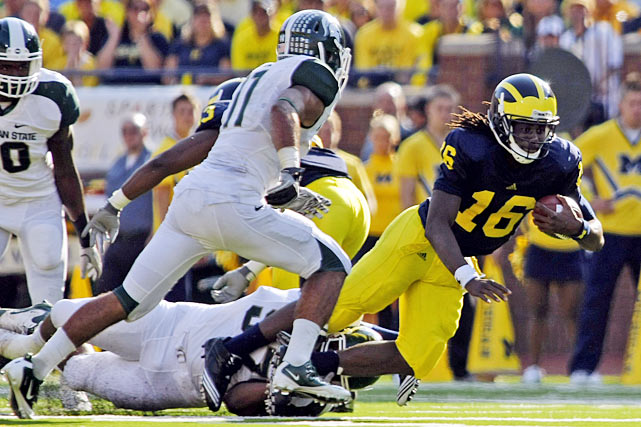 It turns out injury isn't the only thing that can stop Denard Robinson. Michigan State held Michigan's star quarterback in check, limiting him to 215 pass yards, 86 rush yards and two total touchdowns and forcing him into three key interceptions. But ultimately, Michigan's defense was its undoing against MSU. The Spartans trailed midway through the second quarter, but scored 24 unanswered points to secure the Paul Bunyan Trophy for the third year running.