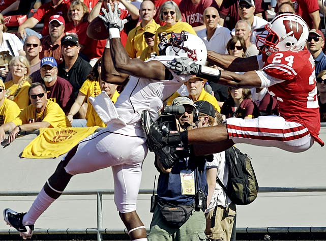 Minnesota wore white helmets and uniforms on an unseasonably hot day, but that didn't help much. The Gophers surrendered five rushing touchdowns to the Badgers, who secured Paul Bunyan's Axe for the seventh straight season.
