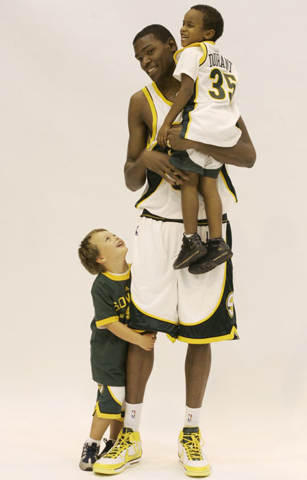 Durant smiles for the camera with some of his littlest admirers during the NBA's Media Day in 2007. The photo was part of the Sonics' campaign to encourage children to read.
