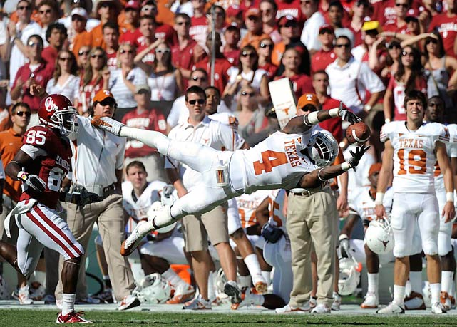 Longhorns cornerback Aaron Williams nearly intercepted a pass intended for Oklahoma wide receiver Ryan Broyles during the first half of their game at the Cotton Bowl in Dallas. Texas fell 28-20 to the No. 8 Sooners.