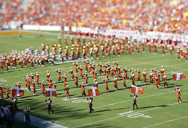 By using a tilt/ shift lens that focuses only a part of the frame, the photographer made the members of the University of Texas band in the foreground stand out like tin soldiers in a diorama as they marched during halftime of the Texas-Oklahoma game at the Cotton Bowl in Dallas.