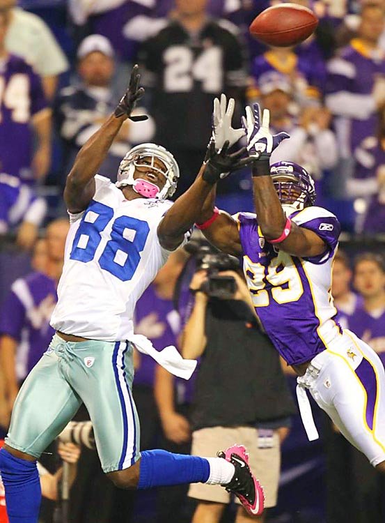 Dallas Cowboys wide receiver Dez Bryant catches a touchdown pass over Minnesota Vikings cornerback Lito Sheppard in the fourth quarter at the Metrodome. The Vikings defeated the Cowboys 24-21.