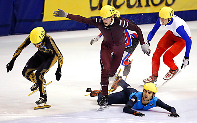 Daisuke Uemura of Japan, left, crosses the finish line as Haralds Silovs of Latvia trips over Anthony Lobello of the U.S. during the 1500 meters qualification race at the ISU World Cup Short Track speed skating competition Oct. 22 in Montreal.