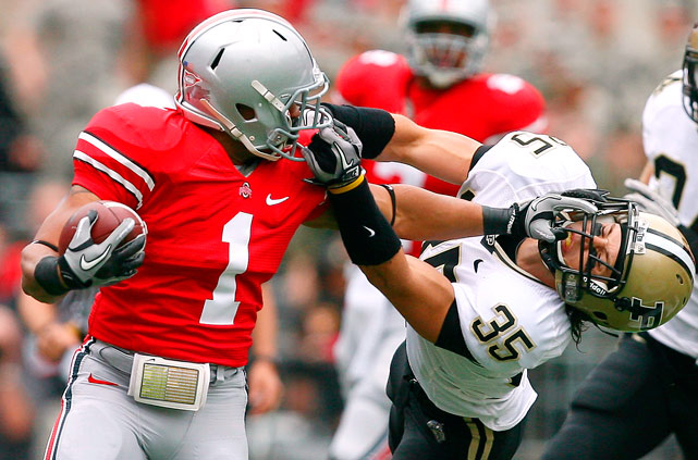 Ohio State running back Daniel Herron gets his head turned around by Purdue safety Logan Link during the Buckeyes 49-0 victory on October 23.