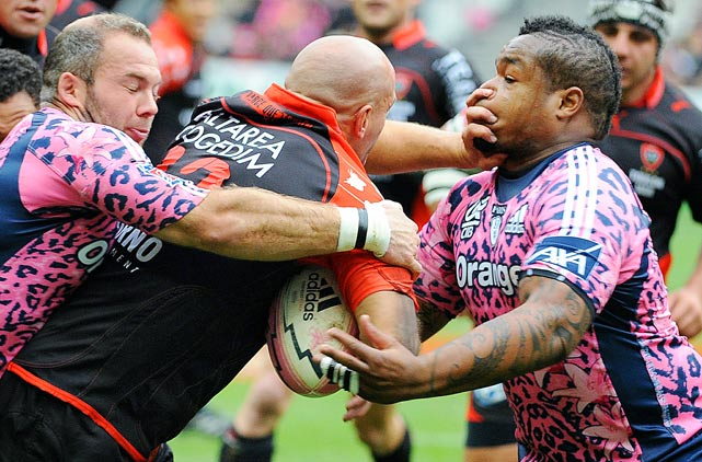 Toulon's Felipe Contepomi gets his hands into the face of Stade Francais' centre Mathieu Bastareaud during the French Top 14 rugby union match on Oct. 23 at the Stade de France in Paris.  Stade Francais defeated Toulon 22-15.
