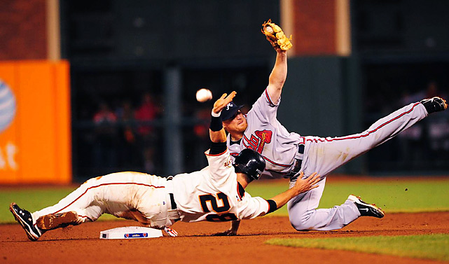 San Francisco Giants catcher Buster Posey slides into second beneath Atlanta Braves second baseman Brooks Conrad during Game 1 of the NLDS.  The Giants went on to win the series 3-1.