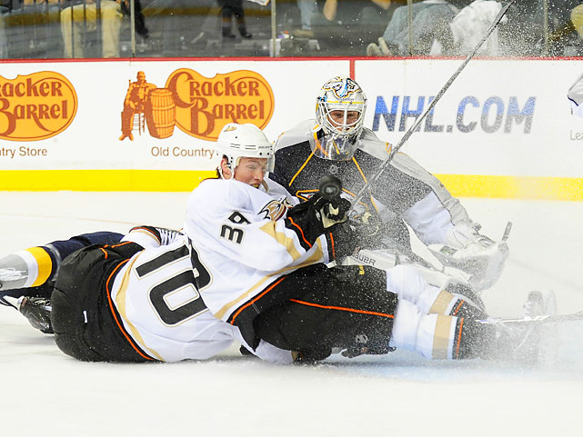 Anaheim Ducks leftwinger Matt Beleskey (center) shaves some ice as he slides into Nashville Predators goalie Pekka Rinne (right) during a Ducks-Predators match on Oct. 9. Nashville won 4-1.