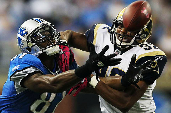 Detroit Lions wide receiver Calvin Johnson (left) stretches for a ball while blanketed by St. Louis Rams cornerback Bradley Fletcher (right).  The Lions decimated the Rams 44-6.