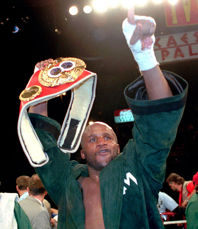 Moorer overcame a second-round knockdown to win a majority decision over Evander Holyfield. He'd cede the title to George Foreman in his first defense.