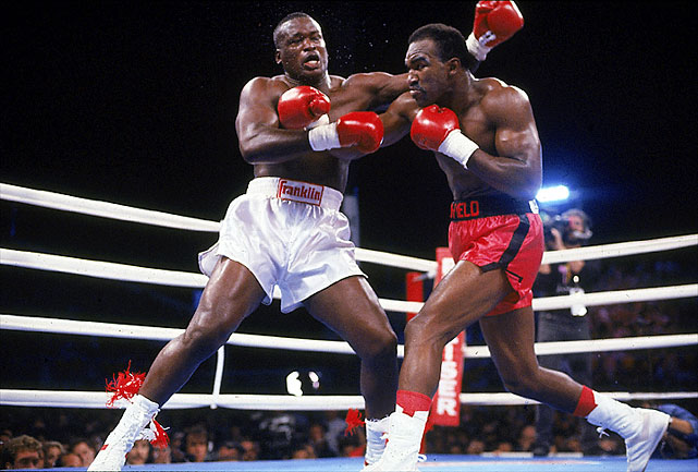 Holyfield knocked out an overweight, underprepared Buster Douglas in the third round at the Mirage Hotel & Casino to win the undisputed heavyweight championship.