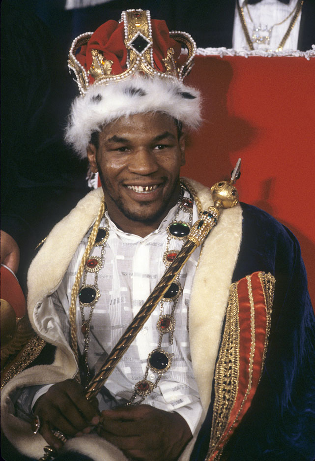 """""""Kid Dynamite"""" became history's youngest heavyweight champion with a November 1986 knockout of Trevor Berbick for the WBC title. He beat Bonecrusher Smith for the WBA title and unified the belts with a knockout of Pinklon Thomas for the IBF title. But not until an utterly dominant 91-second victory over Michael Spinks in 1988 did Tyson earn the lineal title."""