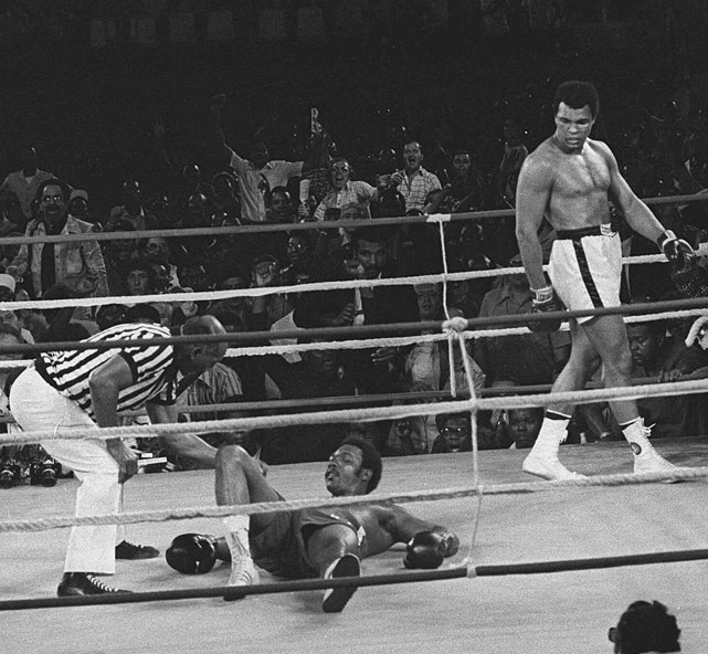 "Ali engineered one of sports' all-time great upsets by knocking out fearsome George Foreman in Zaire on Oct. 30, 1974 -- a fight immortalized as ""The Rumble in the Jungle."" Employing the shrewd, now-famous ""rope-a-dope"" strategy -- leaning on the ropes and absorbing Foreman's ineffective body shots -- Ali waited until the champion punched himself out before dropping him with a well-schooled combination."