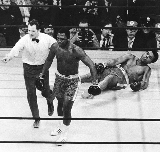 """Smokin' Joe"" was already the undisputed world champion by virtue of his 1970 victory over WBA champion Jimmy Ellis, but not until outpointing Muhammad Ali in the first installment of their legendary trilogy did the Philadelphia slugger add the lineal title."