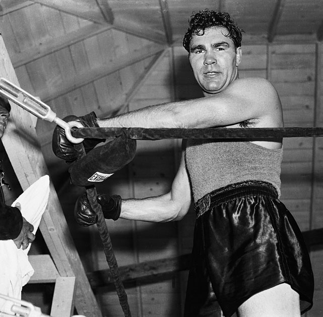 When Gene Tunney retired as champion -- the first of three interruptions of the heavyweight title lineage -- Schmeling fought veteran contender Jack Sharkey for the recognized title on Dec. 6, 1930. He became the first and only heavyweight to win the title on a foul when Sharkey was disqualified in the fourth round for a low blow.