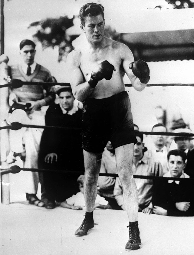The Fighting Marine won the title from Jack Dempsey in 1926 and defended it in their rematch -- the so-called Long Count Fight. He retired as an undefeated heavyweight after his 1928 victory over Tom Heeney. (His lone defeat came against Harry Greb at light heavyweight.)
