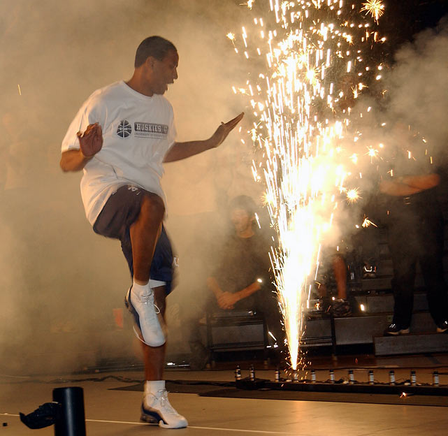 Connecticut guard Caron Butler dances his way onto the floor during 2001 Midnight Madness at Gampel Pavilion.