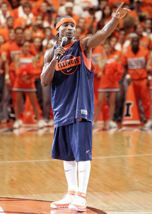 Illinois' Dee Brown addresses the Assembly Hall crowd at the Illini's 2005 Midnight Madness.