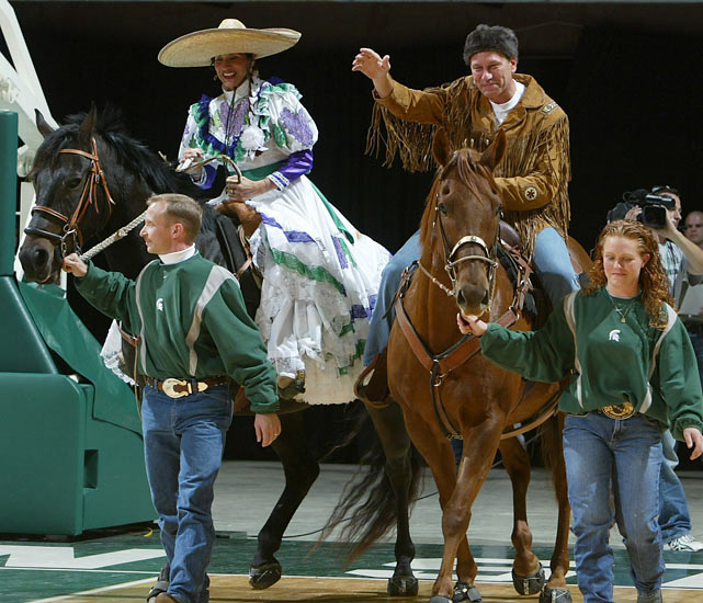 Michigan State basketball coach Tom Izzo makes his entrance on horseback with his wife, Lupe, in 2003.