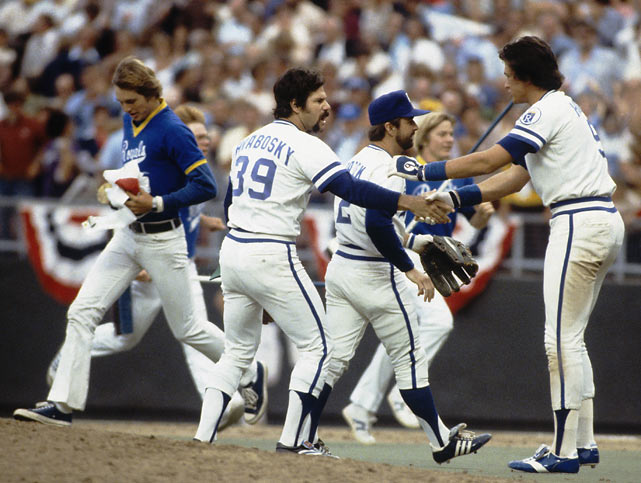 Al Hrabosky, Fred Patek, and Clint Hurdle celebrate after the Royals beat the Phillies in Game 4 of the World Series in Kansas City.