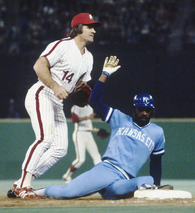 Looking for an out call on Royals' base runner Willie Wilson is Philadelphia's Pete Rose.  Wilson was deemed safe, but didn't fare as well for the rest of the series.  With two outs in the bottom of the 9th inning in Game 6, Wilson struck out, officially cementing Philadelphia as 1980 World Series champions.