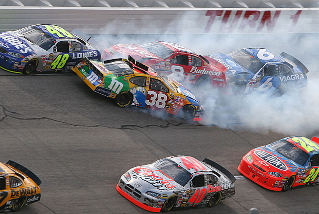 """On Lap 20 of the UAW Ford 500 at Talladega, Mark Martin, Michael Waltrip, Dale Earnhardt Jr. and Elliott Sadler were among the drivers caught in """"The Big One."""" After a nudge by Jimmie Johnson, Sadler's car was turned and pushed into oncoming traffic, sending several cars into the wall or careening into the grass."""