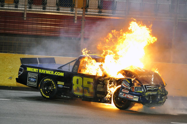 Brett Raymer's ride caught fire coming off Turn 4 during this year's Education Lottery 200 at Charlotte. The car spun into the wall before settling on the outside lanes of the track. Raymer jumped out of the truck and crews rushed in to put out the blaze.