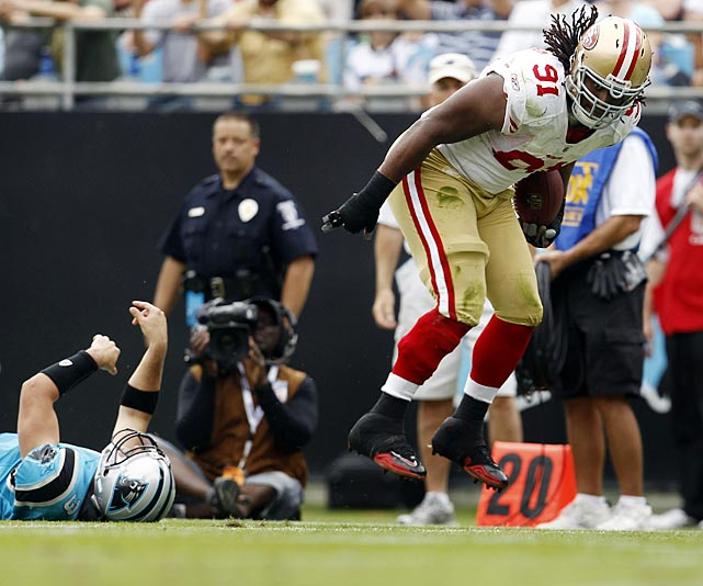 Ray McDonald was the beneficiary of a foolish Matt Moore throw, scooping up a hurried pass and thundering 31 yards for a score to give the 49ers a 20-13 lead in Week 7.  His celebration would be short-lived, however, as Carolina bounced back to post the game's final 10 points, securing a 23-20 triumph over Mike Singletary's struggling squad.