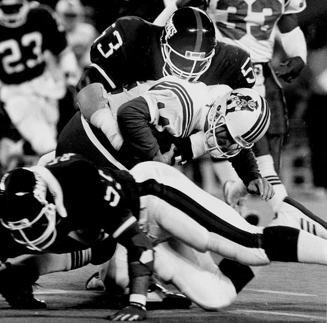 New York linebacker Harry Carson smothers New England quarterback Steve Grogan during the Giants' 17-10 victory in Week 9.  Though New York stumbled to a 6-9 record in 1987, Carson delivered an impressive campaign, notching a sack and a fumble recovery in the strike-plauged season.  Carson was also named to the Pro-Bowl for the ninth and final time in his illustrious career.