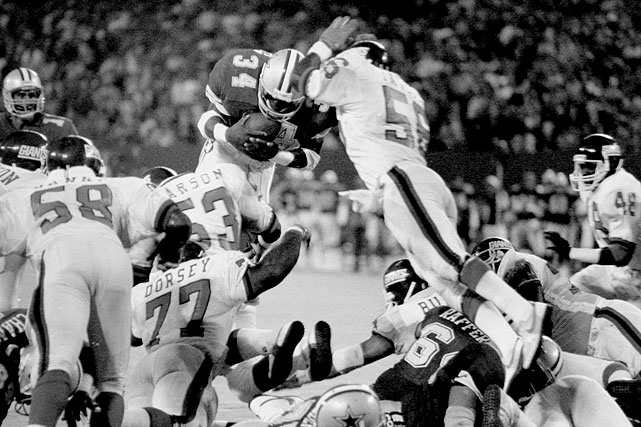 A Heisman Trophy winner at the University of Georgia, running back Herschel Walker was dynamic in the NFL as well, breaking past defenses for 19 touchdowns in his first two years for the Dallas Cowboys.  He didn't do any scoring during this Sept. 21 game against the New York Giants, though, as a diving Walker was stifled by a similarly airborne Lawrence Taylor.  Despite the stand, Dallas prevailed 16-14.