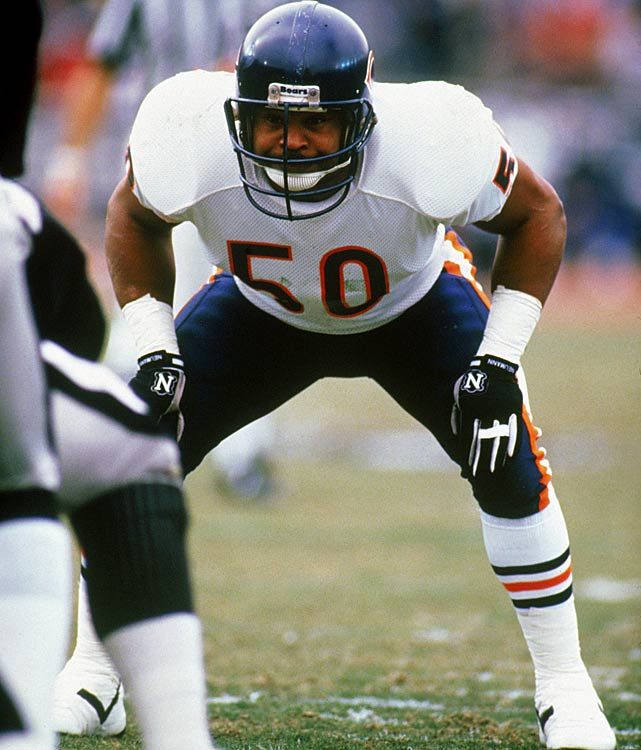 "One of the revered ""Monsters of the Midway,"" linebacker Mike Singletary readies himself during their Dec. 27 showdown with the Los Angeles Raiders.  Singletary's defense would key a 6-3 Chicago win, propelling the Bears into a divisional playoff game against the Washington Redskins on Jan. 10.  The Bears weren't as fortunate in that contest, losing 21-17."