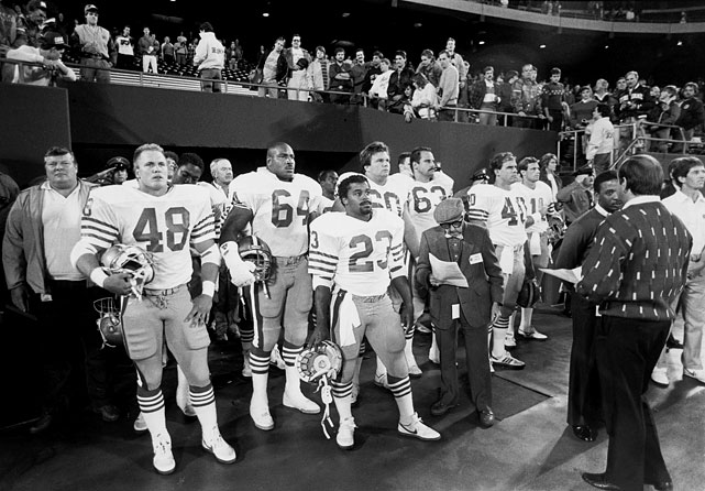 "Jokingly dubbed the San Francisco ""Phoney-Niners,"" replacements Mike Varajon (48), Michael Durrette (64) and Tony Cherry (23) prepare to take the field before a game against the New York Giants in Week 3.  The replacements fared well in their Monday Night contest, knocking off what remained of the defending champs 41-21.  San Francisco didn't miss a beat during the 1987 players' strike, winning all three games that its stars missed."