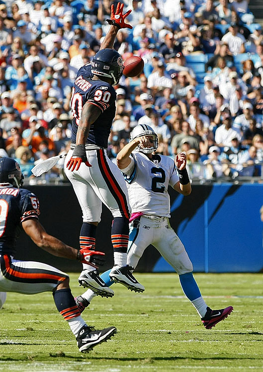In his return to Carolina, after signing a lucrative contract with the Chicago Bears in the offseason, Julius Peppers didn't record a sack.  But it's hard to record a sack when a team is doing everything in its power to prevent you from the satisfaction of flattening its quarterback.  Stymied by offensive linemen, Peppers did something altogether more impressive: He tipped a pass to himself, fell to his knees and somehow still managed to secure the ball for an interception.  After the play, Peppers put a finger over his mouth to hush the home crowd, not that they were saying much after that play.