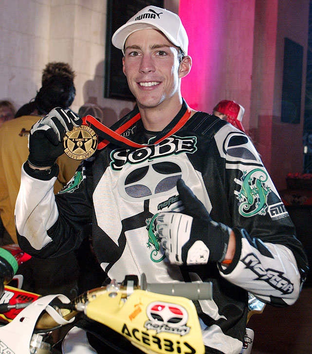 Nineteen-year-old Pastrana proudly holds up his fourth X Games gold medal after beating out Nate Adams and Brian Deegan in the Moto X Freestyle contest.