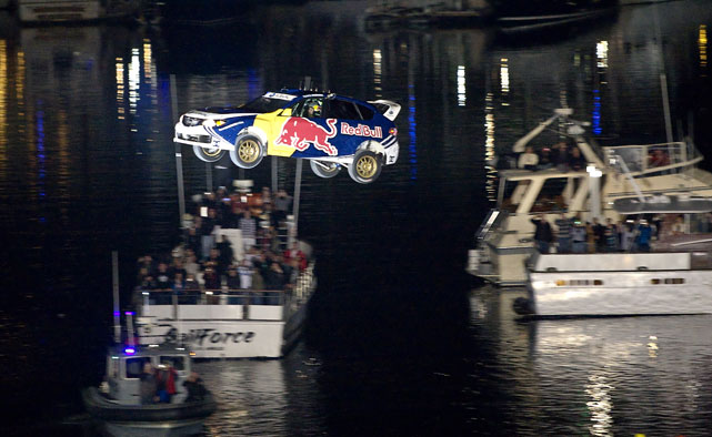 Strapped into his Red Bull Subaru Impreza rally car, Pastrana crushed Ken Block's 171-foot jump by launching his car 274 feet from Long Beach, Calif.'s Pine Street Pier onto a barge.