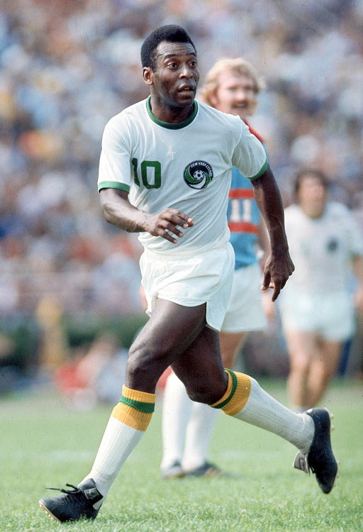 Pele runs along the pitch during a game against the Dallas Tornadoes.  He made 64 appearances as a member of the New York Cosmos.