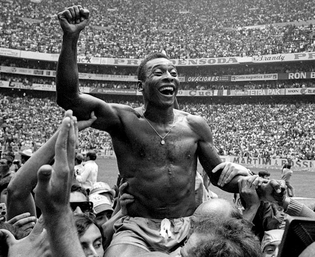 A shirtless Pele is hoisted off the pitch after the 1970 World Cup final.  It was a return to form for him, as he missed parts of the 1962 and 1966 tournaments due to injury.