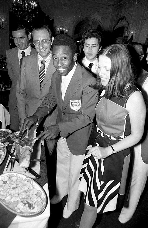 Pele prepares to slice up some meat during a 1974 event.  He is better known for slicing up his competition.