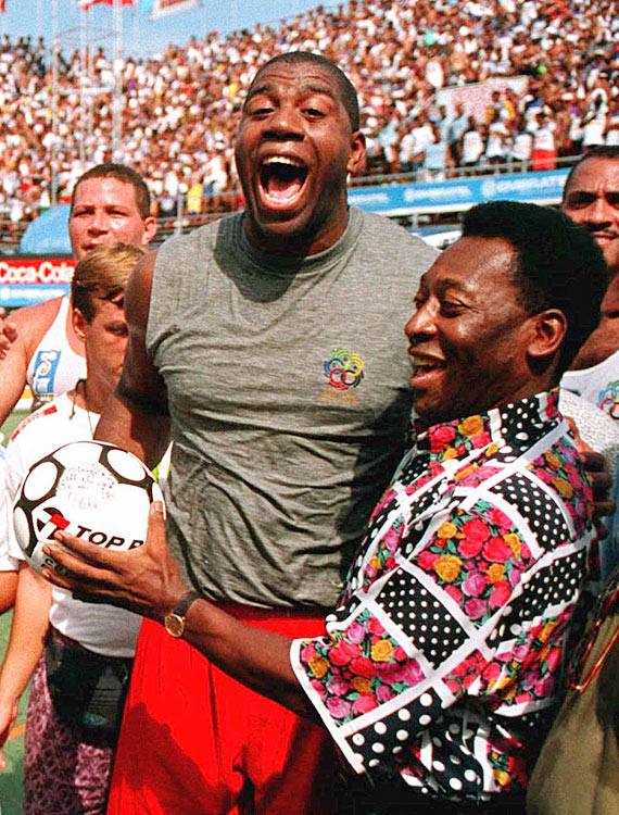 Pele presents an autographed ball to Magic Johnson during his time in Rio de Janeiro.  Johnson, a terrific athlete himself, was clearly pleased at receiving the souvenir.