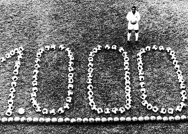 Pele stands among a display to recognize his 1000th professional goal.  He finished with 1,281 goals -- making him the top scorer of all time.