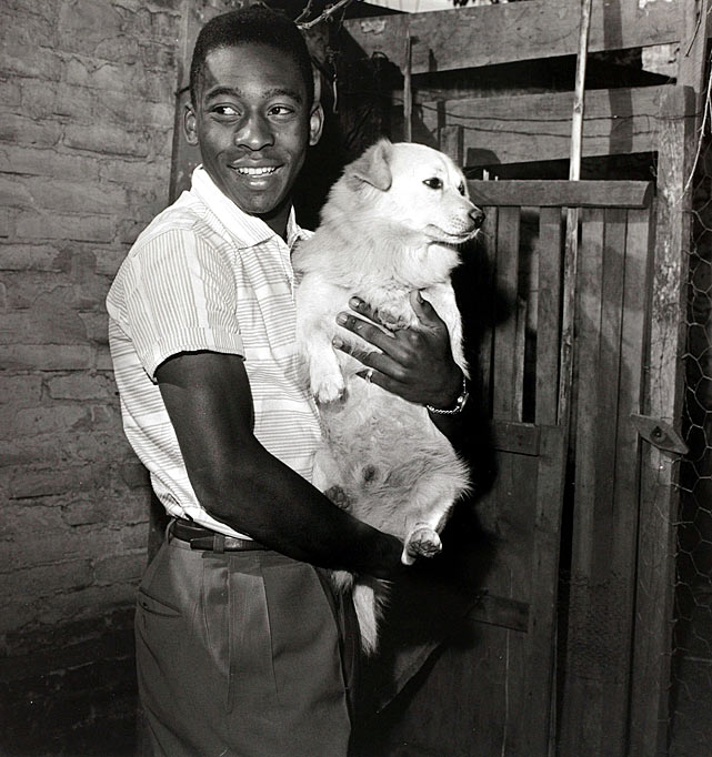 A boyish-looking Pele cradles a puppy circa 1958.