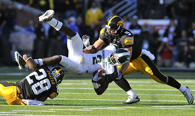A week after suffering a crushing one-point loss to Wisconsin, Iowa exploded for a 30-0 halftime lead over Michigan State and never faltered, upending the Spartans' undefeated season and throwing the Big Ten and Rose Bowl races into chaos. Iowa, Michigan State, Ohio State and Wisconsin are all still alive.