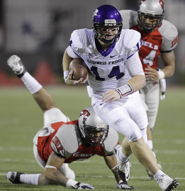 Four different Horned Frogs scored rushing touchdowns and No. 4 TCU bulldozed UNLV in a 42-point blowout. Quarterback Andy Dalton (left) scored once on the ground and completed 16 of 23 passes for 252 yards and two touchdowns on Saturday.