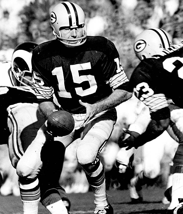 Bart Starr delivers the handoff to Travis Williams during a matchup with the Los Angeles Rams.
