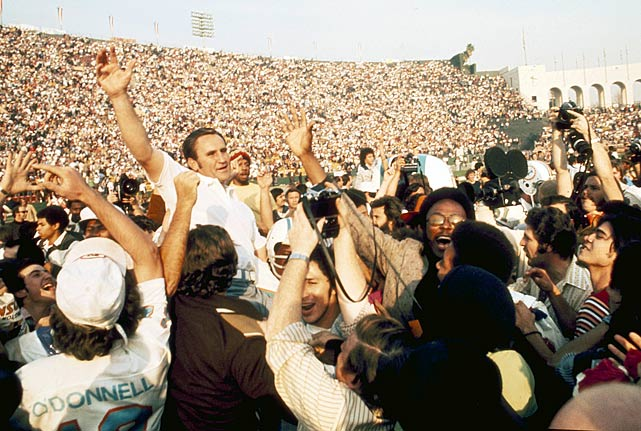 Head coach Don Shula is carried off the field after his 1972 Dolphins completed their perfect season with a victory in Super Bowl VII.