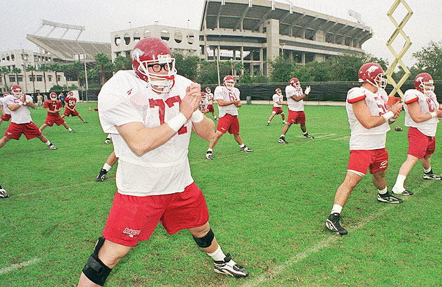 A walk-on for the Arkansas Razorbacks in 1996, Burlsworth eventually became a second-team All-America and a third-round pick of the Indianapolis Colts.    Starting this year, the Burlsworth Trophy, a national award in Burlsworth's honor, will be handed out to a college football player who started his career as a walk-on. SI.com takes a look at other players who had to work their way on to the varsity squad.