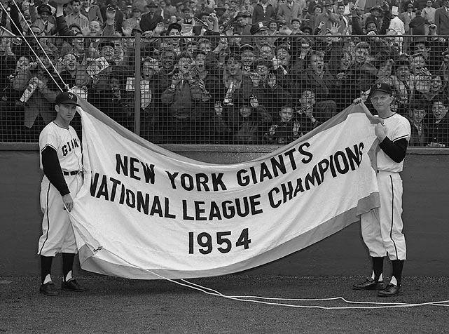 On opening day 1955, Alvin Dark and Whitey Lockman unfurled the Giants National League pennant before a game against the Brooklyn Dodgers.