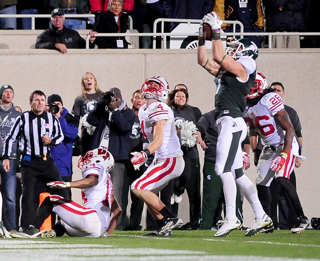 With the game tied at 31, Michigan State had one last chance for victory over Wisconsin. Spartans quarterback Kirk Cousins lofted the ball toward the endzone, where it caromed off Michigan State receiver B.J. Cunningham's facemask back to Keith Nichol on the one-yard line. Nichol fought two Wisconsin defenders but was ruled just short of the endzone. The play was reviewed upstairs and overturned, giving the Spartans an unlikely victory.  This was just one of several amazing Hail Mary finishes in football history.  Here are some more.