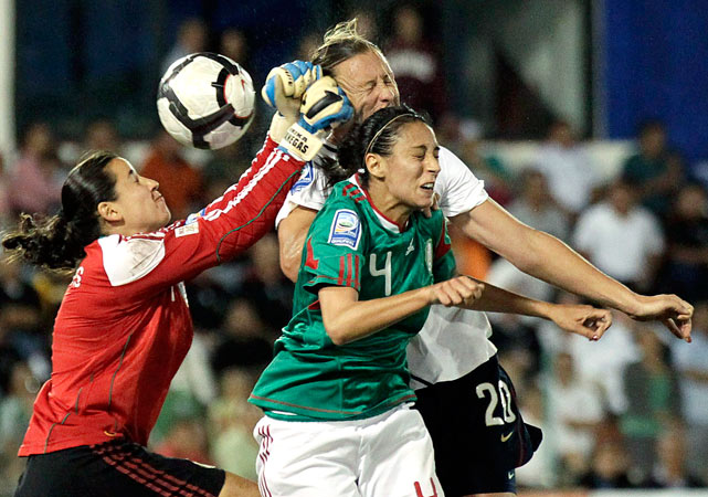 Mexico's goalkeeper Erika Vanegas and Natalie Vinti jump for the ball against Abby Wambach of the U.S. during their semifinal match of the CONCACAF Women's World Cup qualifying tournament Nov. 5 at Beto Avila stadium in Cancun. Mexico defeated the U.S. 2-1.